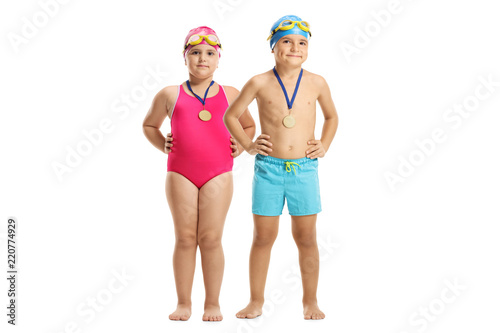 Young Boy And Girl In A Swimming Suits With Gold Medals Stock Photo