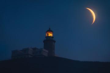 Matxitxako lighthouse at night with big moon