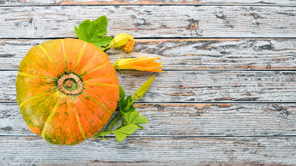 Pumpkin. Fresh vegetables. On a white wooden background. Free space for text. Top view.