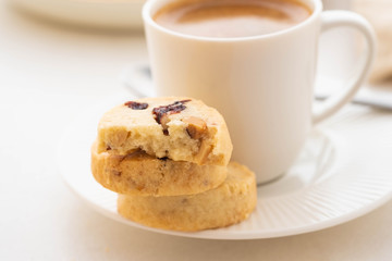 A cup of coffee with homemade cookies on a white background.