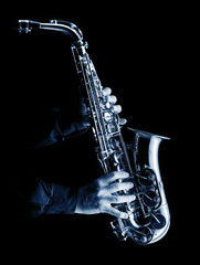 musician playing alt saxophone on black,blue image