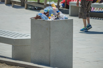 an urn with garbage on the street
