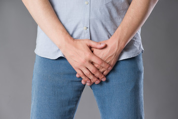 Pain in prostate, man suffering from prostatitis or from a venereal disease