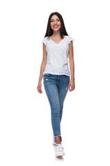 joyful casual woman wearing jeans walking