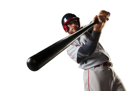 Isolated Baseball player bat the ball on white background