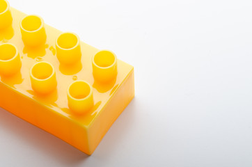yellow plastic block on white background
