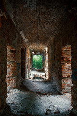 Corridor in ruined, abandoned ancient brick aged castle building