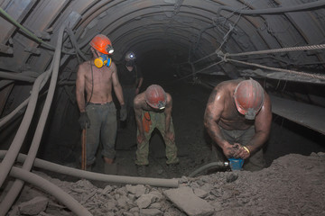 Miners work in underground mining. Donetsk, Ukraine