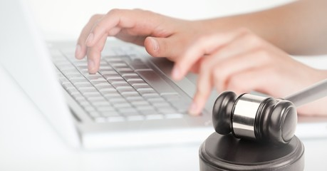Gavel and keyboard on laptop