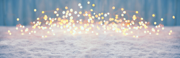 Abstract magic winter landscape with snow and golden bokeh lights - Banner, Panorama