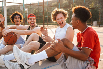 Group of young cheerful multiethnic men
