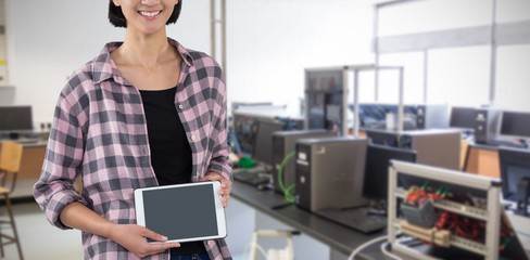 Composite image of smiling woman showing digital tablet against