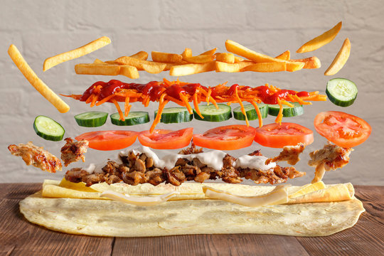 Traditional lavash dish with levitating ingredients from meat and vegetables.