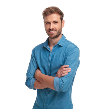 young smiling casual man standing with hands crossed