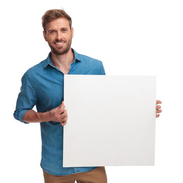 happy casual man holding a blank message