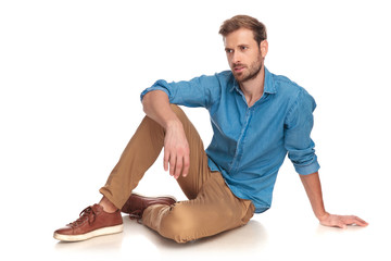 side view of a fashion man sitting down