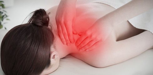 Composite image of redhaired woman having a rolling massage