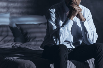 Lonely businessman with insomnia problem