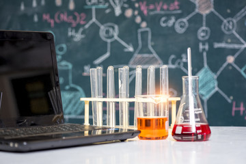 scientist concept, equipment and science experiments ,Laboratory glassware containing chemical liquid in the classroom