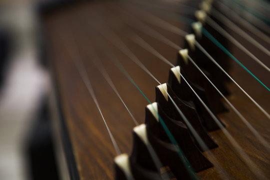 Gu Zheng. The Zheng is a traditional Chinese musical instrument. Itbelongstothezitherfamilyofstringinstruments.