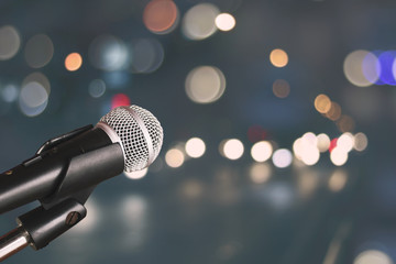Microphone on blur bokeh of light and hall background, Music and singing concept