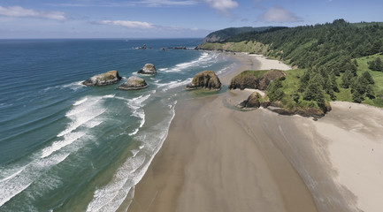 Aerial panorama shot at approximately 350 feet above Cannon Beach looking towards Ecola State Park in the summer on the Oregon Coast