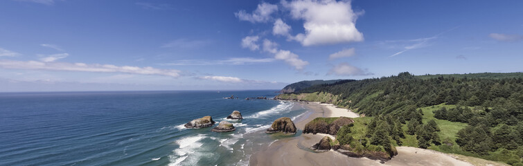 Aerial wide panorama shot at approximately 350 feet above Cannon Beach looking towards Ecola State Park on the Oregon Coast
