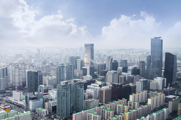 Fotobehang Seoel Seoul cityscapes, skyline, high rise office buildings and skyscrapers in Seoul city, winter daylight, top view in winter, Seoul, Republic of Korea, in mist winter season with blue sky and cloud