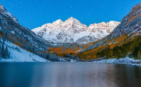 fall color at Maroon lake at night after snow in Aspen, Colorado