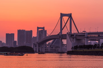 Wall Mural - Tokyo skyline and rainbow bridge at sunset in Odaiba waterfront.
