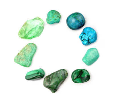 Circle of polished gemstones, green and turquoise color , isolated on white background