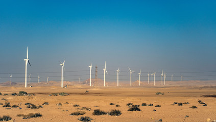 Electric wind turbine generators in the desert in Egypt.
