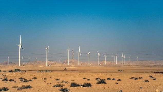 Electric wind turbine generators in the desert in Egypt.