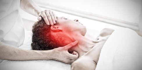 Composite image of woman receiving neck massage in spa