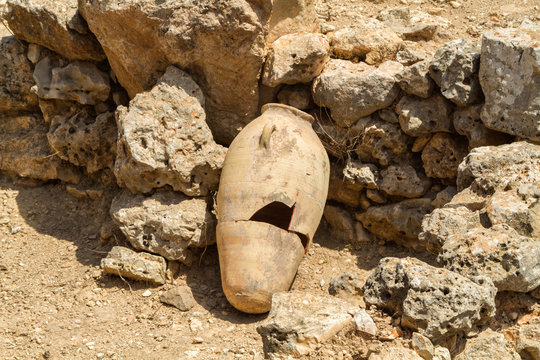 Old jug near stone wall, archaeological park of Shiloh, Israel