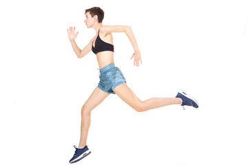 Full length active young woman jumping on isolated white background