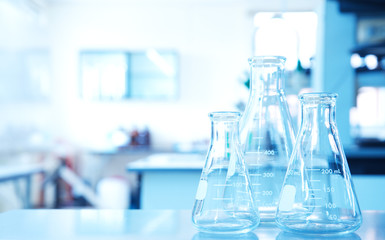 three glass flask in science technology education laboratory background