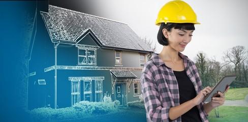 Composite image of female architect using digital tablet against