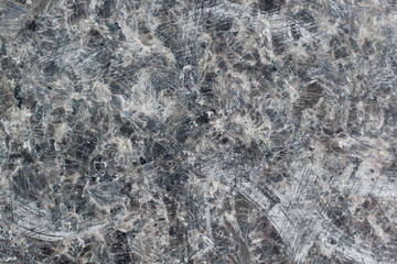 Granite texture with black and gray spots. Used as a background.