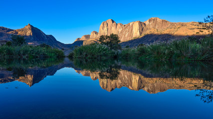 Tsaranoro Massif reflected in dam, Andringitra National Park, Madagascar