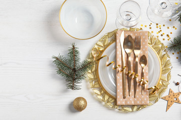 Elegant table setting and space for text on light background, top view. Christmas celebration