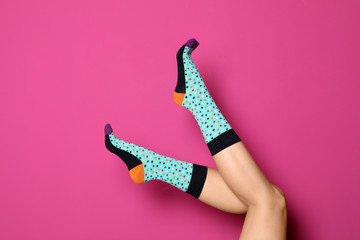 Woman wearing bright socks on color background Wall mural