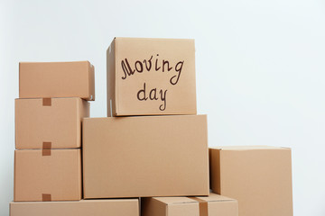 Pile of moving boxes on white background