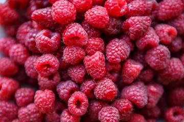 Delicious ripe raspberries on plate