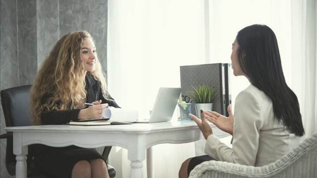 young business woman applicant and human resources his conversation recruitment procedure in corporation.