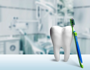 Big tooth model and toothbrush on light background