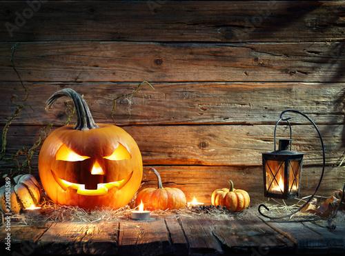 Halloween Pumpkins In Rustic Background With Lantern