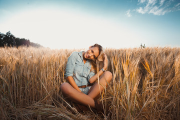 The girl in the field.Girl on nature.Girl smiling