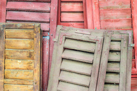 Stack of weathered louver doors