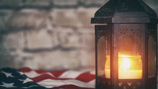 Lighted candle with an American flag, background